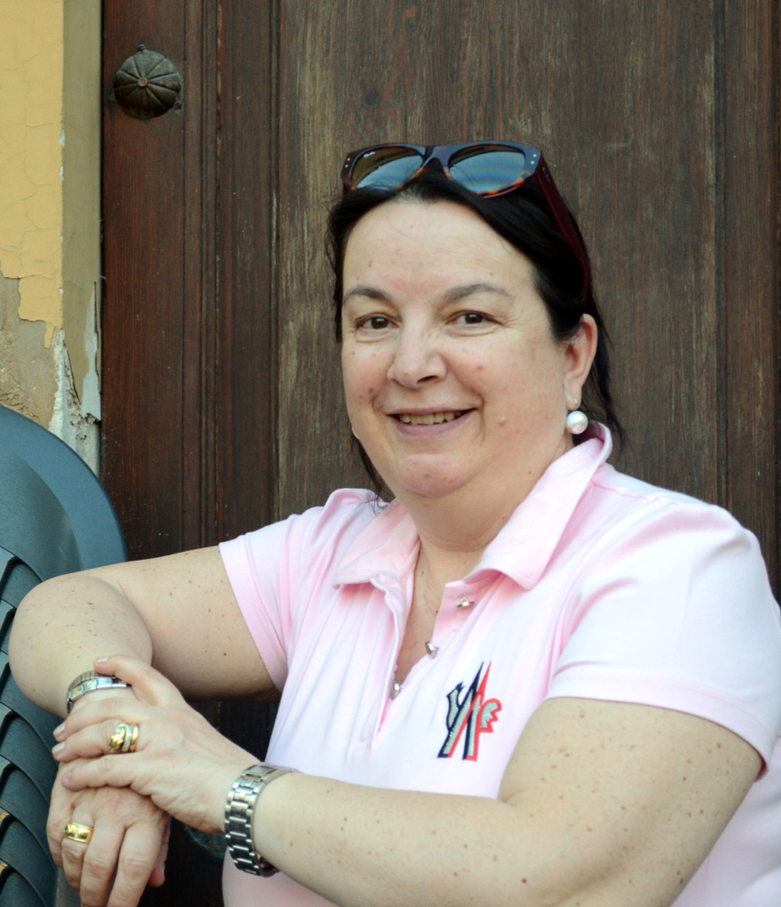 Giovanna Gionni, a Cagli resident and schoolteacher in Frontone, poses outside Cafe d' Italia in June 2013. Photo by Heather Schmitt/Gonzaga in Cagli