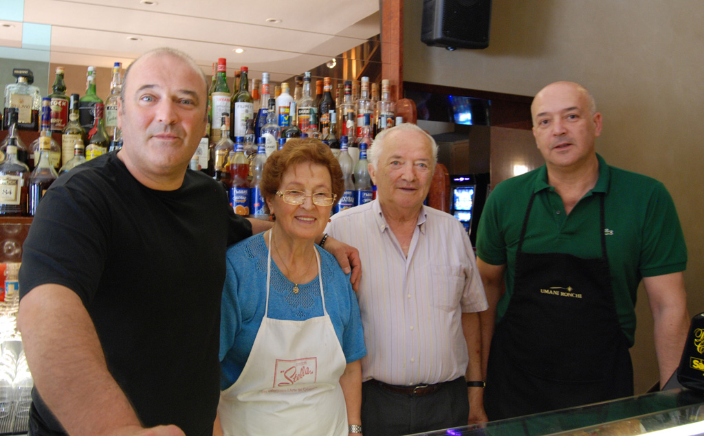 Jake and his family in the Caffe., Photo by Neal Geller Gonzaga in Cagli