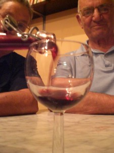 Raul Fortini pouring his homemade wine